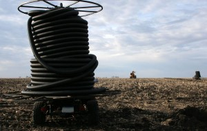 Drainage Solutions: tile trailer in field
